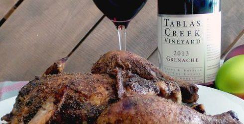Garam Chicken and bottle of red wine